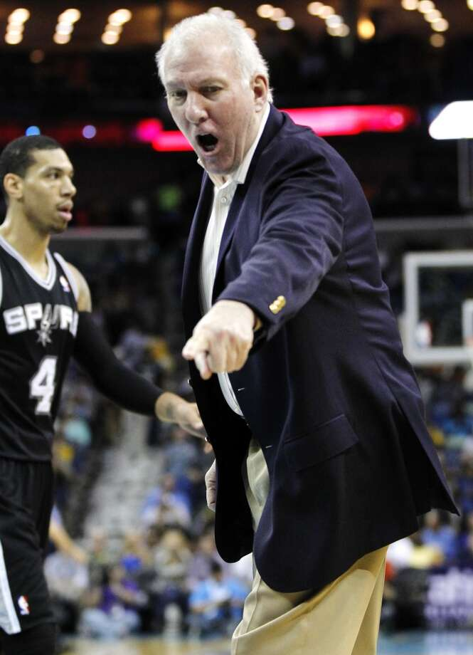 San Antonio Spurs head coach Gregg Popovich complaints to officials in the first half of an NBA basketball game against the New Orleans Hornets in New Orleans, Wednesday, Oct. 31, 2012. (AP Photo/Gerald Herbert) (Associated Press)