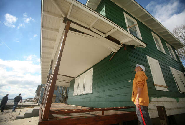 David Hatch checks out the damage from Hurricane Sandy to his waterfront home at 130 Shorefront Drive in Milford on Wednesday, October 31, 2012. Photo: Brian A. Pounds