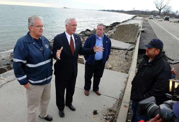 Mayor Bill Finch, with arms raised, speaks to the media as he and other officials tour damage left behind from Hurricane Sandy at Seaside Park in Bridgeport, Conn. on Wednesday October 31, 2012. At left is Parks and Recreation Director Charles Carroll. At right is City Council President Tom McCarthy. Photo: Christian Abraham