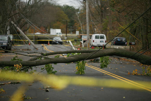 Tree downed power lines at broken utility poles block West Avenue in Milford in the aftermath of Hurricane Sandy on Wednesday, October 31, 2012. Photo: Brian A. Pounds