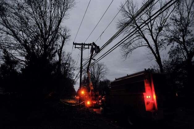 Connecticut Light & Power crews work to repair wires on Newfield Avenue between Case Road and Denicola Place in Stamford, Conn. on Wednesday, Oct. 31, 2012. Crews worked into the night in an effort to restore power to residents after severe damage from the effects of Hurricane Sandy left many in the city in the dark. Photo: Cathy Zuraw