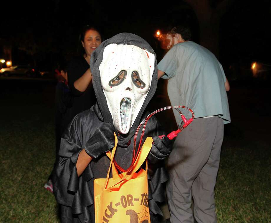 Jude Philips, 9, trick-or-treats in the New Territory subdivision on Halloween night, Wednesday, Oct. 31, 2012, in Sugar Land. Photo: Karen Warren, Houston Chronicle / © 2012  Houston Chronicle