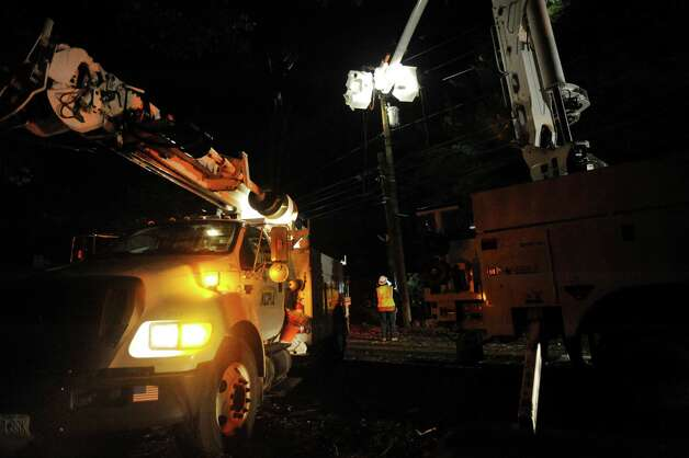 KCP&L crews, out of Kansas City, Mo., work to repair wires on Newfield Avenue between Case Road and Denicola Place in Stamford, Conn. on Wednesday, Oct. 31, 2012. Crews worked into the night in an effort to restore power to residents after severe damage from the effects of Hurricane Sandy left many in the city in the dark. Photo: Cathy Zuraw, Connecticut Post / Stamford Advocate