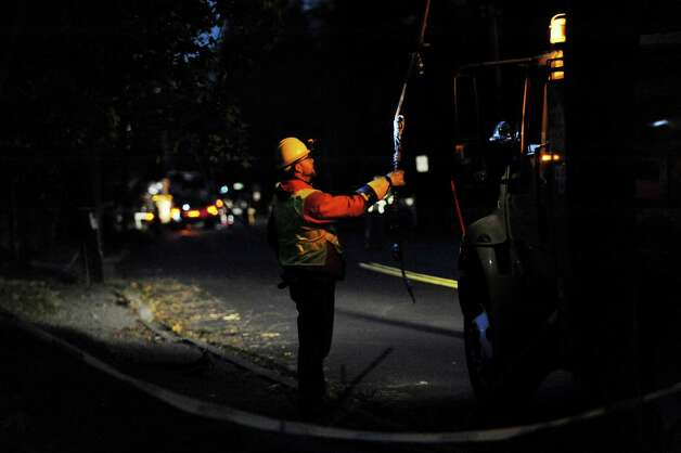 Connecticut Light & Power crews work to repair wires on Newfield Avenue between Case Road and Denicola Place in Stamford, Conn. on Wednesday, Oct. 31, 2012. Crews worked into the night in an effort to restore power to residents after severe damage from the effects of Hurricane Sandy left many in the city in the dark. Photo: Cathy Zuraw, Connecticut Post / Stamford Advocate
