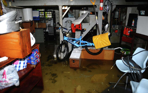 Seaside Village resident Vien Lo's flooded basement as a result of damage left behind by Hurricane Sandy at the village in Bridgeport, Conn. on Wednesday October 31, 2012. Photo: Christian Abraham, Connecticut Post / Connecticut Post