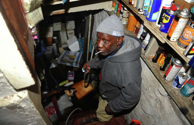 Seaside Village resident James Brown shows his flooded basement which was a result of Hurricane Sandy at the village in Bridgeport, Conn. on Wednesday October 31, 2012. Photo: Christian Abraham, Connecticut Post / Connecticut Post