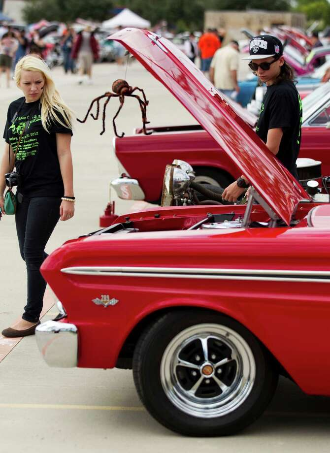 Cheyenne Brown, left, and Justin Keeney walk through the cars on display during the 5th Annual Halloween Classic car show at the National Museum of Funeral History Saturday, Oct. 20, 2012, in Houston. Photo: Brett Coomer, Houston Chronicle / © 2012 Houston Chronicle