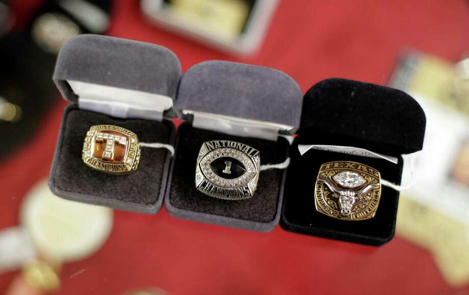 Rings from Texas' national championship teams will be among the memorabilia auctioned off by Darrell Royal's wife, Edith, below. Photo: Eric Gay, STF / AP