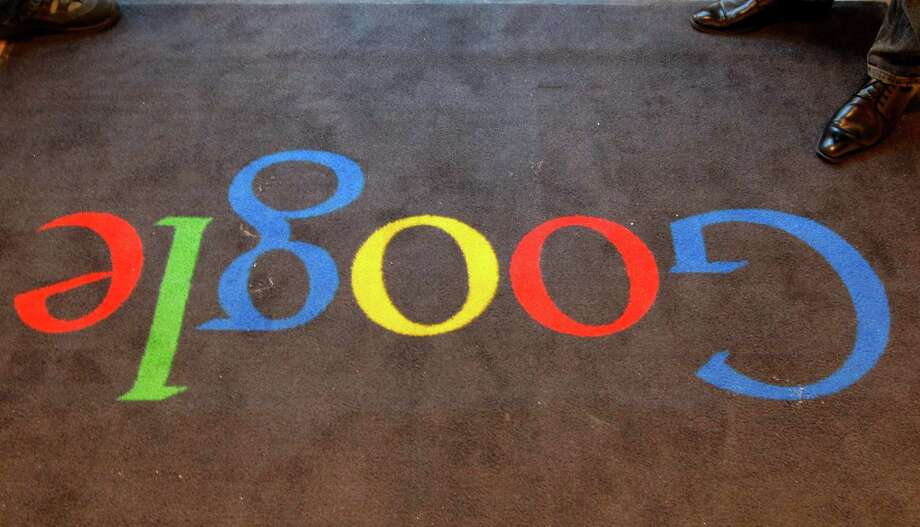 """FILE - In this Dec.6, 2011 file photo, the Google logo is seen on the carpet at Google France offices before its inauguration, in Paris. Publishers in France, Germany and Italy want their governments to impose a """"news tax"""" on Google to save them from extinction, demanding a law that would charge the search engine small payments in exchange for links to stories. Google, in response, says it will cease to index the sites altogether, warning that the proposals do nothing to solve the industry's problems on the continent that invented the printing press. (AP Photo/Jacques Brinon, Pool, File) Photo: Jacques Brinon"""