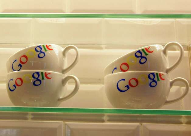"FILE - In this Dec. 6, 2011 file photo, cups bearing the Google logo are displayed at Google France offices before its inauguration, in Paris. Publishers in France, Germany and Italy want their governments to impose a ""news tax"" on Google to save them from extinction, demanding a law that would charge the search engine small payments in exchange for links to stories. Google, in response, says it will cease to index the sites altogether, warning that the proposals do nothing to solve the industry's problems on the continent that invented the printing press. (AP Photo/Jacques Brinon, Pool, File) Photo: Jacques Brinon"