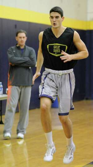 UAlbany center John Puk practices with the basketball team Wednesday, Oct. 31, 2012 in Albany, N.Y.