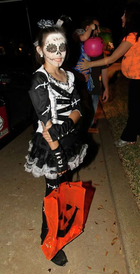 Annabelle Vasquez, 9, dressed as a zombie bride as she trick-or-treated in the New Territory subdivision on Halloween night, Wednesday, Oct. 31, 2012, in Sugar Land. Photo: Karen Warren, Houston Chronicle / © 2012  Houston Chronicle