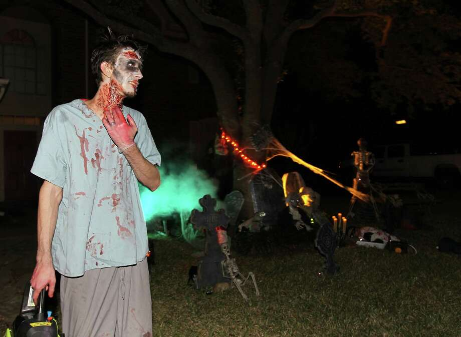 Clayton Dorsey dressed as a zombie for the trick-or-treaters in front of his house in the New Territory subdivision on Halloween night, Wednesday, Oct. 31, 2012, in Sugar Land. Photo: Karen Warren, Houston Chronicle / © 2012  Houston Chronicle