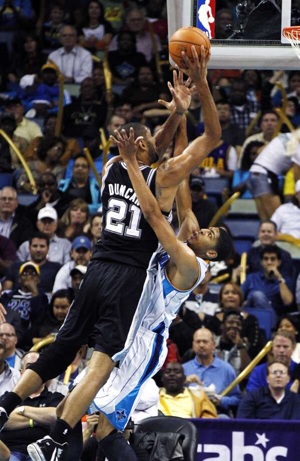 San Antonio Spurs power forward Tim Duncan (21) drives to the basket over New Orleans Hornets power forward Anthony Davis (23) in the first half of an NBA basketball game in New Orleans, Wednesday, Oct. 31, 2012. (AP Photo/Gerald Herbert) (Associated Press)