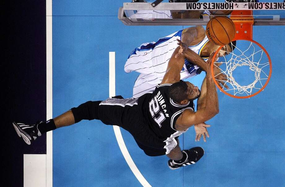 San Antonio Spurs power forward Tim Duncan (21) drives to the basket against New Orleans Hornets power forward Anthony Davis in the first half of an NBA basketball game in New Orleans, Wednesday, Oct. 31, 2012. (AP Photo/Gerald Herbert) (Associated Press)