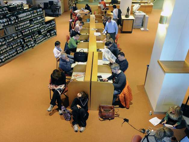 A crowded Greenwich Library, Wednesday morning, Oct. 31, 2012. With much of Greenwich without electricity due to Hurricane Sandy, the library and its amenities have become a gathering spot for the community. Photo: Bob Luckey / Greenwich Time