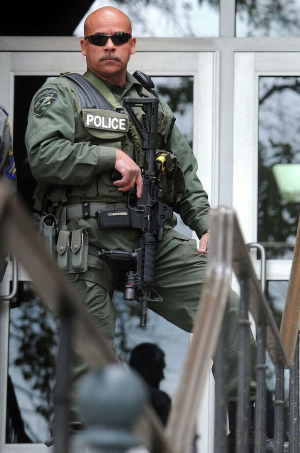 A Bridgeport Police Department SWAT Team stands guard in front of the Golden Hill Street courthouse, in Bridgeport, Conn. after a fight broke out during a muder arraignment on Wednesday, Oct. 31st, 2012. Photo: Ned Gerard / Connecticut Post