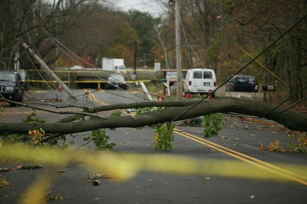 Tree downed power lines at broken utility poles block West Avenue in Milford in the aftermath of Hurricane Sandy on Wednesday, October 31, 2012. Photo: Brian A. Pounds / Connecticut Post