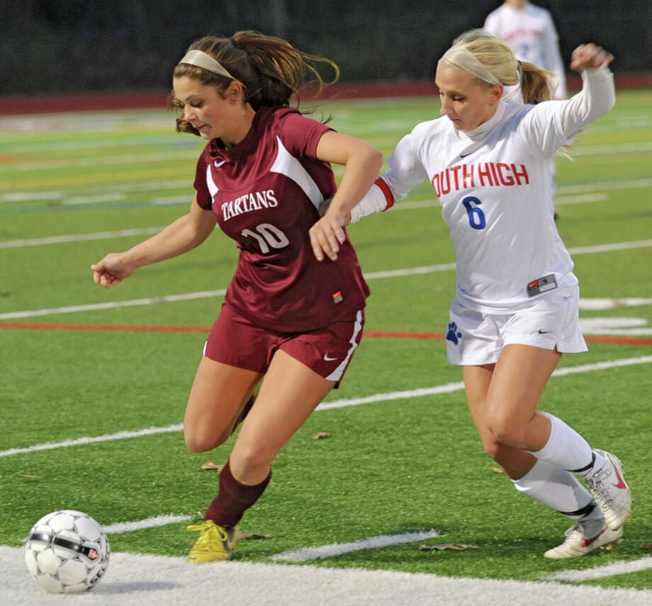 From left, Sophie Constantino of Scotia tries to stop the ball from going out of bounds as Paige Howk of South Glens Falls covers her during a Class A Section ll semifinals soccer game on Wednesday, Oct. 31, 2012 in Stillwater, N.Y. (Lori Van Buren / Times Union) Photo: Lori Van Buren