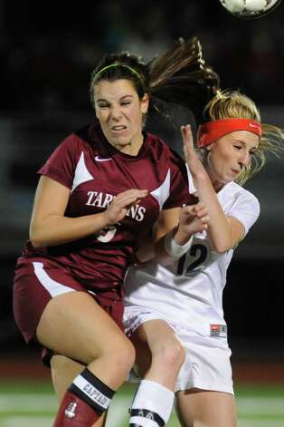 From left, Morgan Bailey of Scotia tries to head the ball with Kayla Lingel of South Glens Falls during a Class A Section ll semifinals soccer game on Wednesday, Oct. 31, 2012 in Stillwater, N.Y. (Lori Van Buren / Times Union) Photo: Lori Van Buren