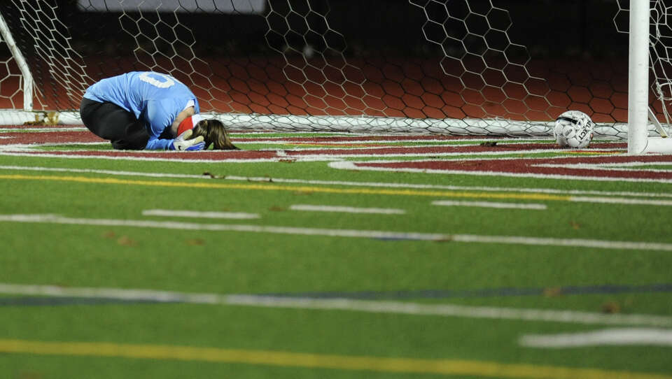 Goal keeper Amy Jagareski of South Glens Falls buries her head in her head after letting the winning