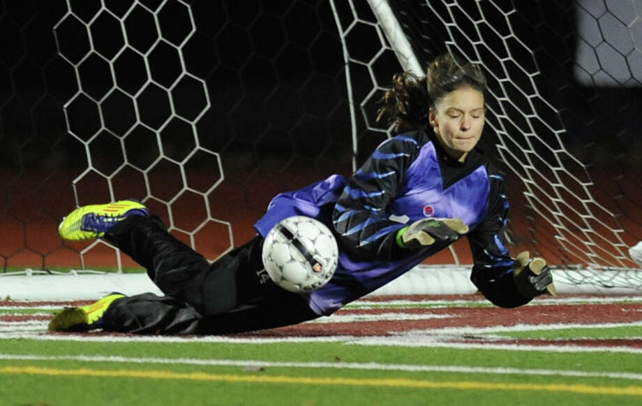 Scotia- Glenville goal keeper Carina Morgan dives to save a goal during a Class A Section ll semifinals soccer game against South Glens Falls on Wednesday, Oct. 31, 2012 in Stillwater, N.Y. (Lori Van Buren / Times Union) Photo: Lori Van Buren