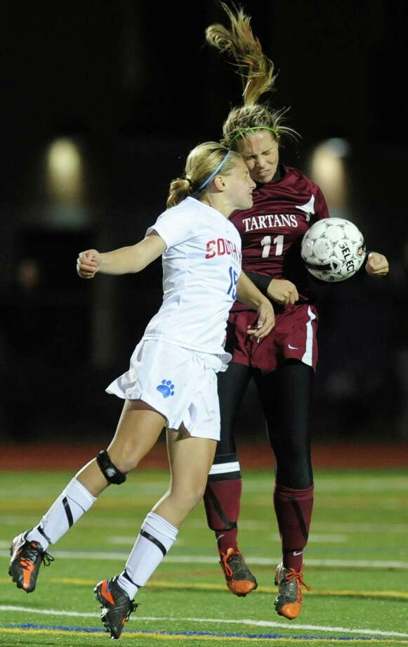 From left, Liz Spada of South Glens Falls battles for the ball with Rachael Cox of Scotia during a section ll semifinals soccer game on Wednesday, Oct. 31, 2012 in Stillwater, N.Y. (Lori Van Buren / Times Union) Photo: Lori Van Buren