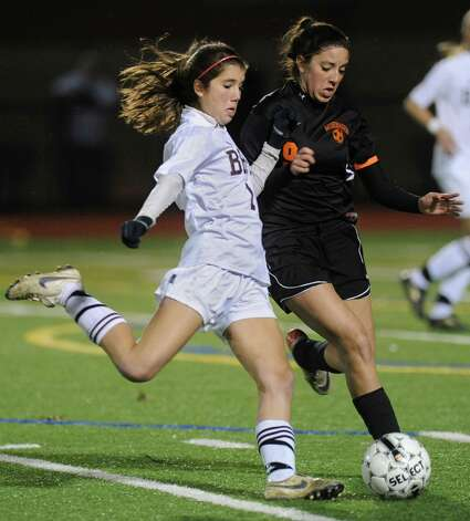 From left, Skye Kaler of Burnt Hills battles for the ball with Morgan Miller of Mohonasen during a section ll semifinals soccer game on Wednesday, Oct. 31, 2012 in Stillwater, N.Y. (Lori Van Buren / Times Union) Photo: Lori Van Buren