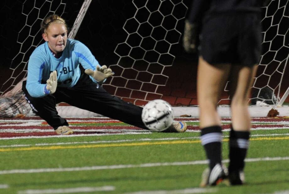 Burnt Hills goal keeper Florie Comley saves the ball from going into her net during a section ll semifinals soccer game against Mohonasen on Wednesday, Oct. 31, 2012 in Stillwater, N.Y. (Lori Van Buren / Times Union) Photo: Lori Van Buren