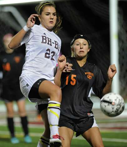 From left, Meghan Malone of Burnt Hills battles for the ball with Celena Maliszewski of Mohonasen during a section ll semifinals soccer game on Wednesday, Oct. 31, 2012 in Stillwater, N.Y. (Lori Van Buren / Times Union) Photo: Lori Van Buren