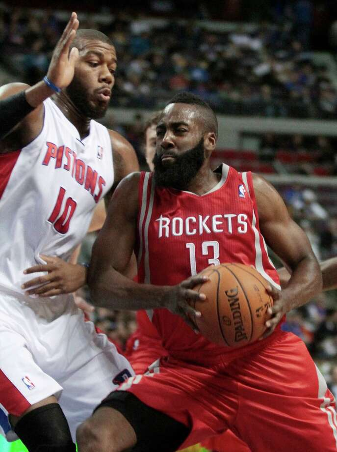 Houston Rockets guard James Harden (13) drives to the basket against Detroit Pistons center Greg Monroe (10) duringg the first half of an NBA basketball game Wednesday, Oct. 31, 2012, in Detroit. (AP Photo/Duane Burleson Photo: Duane Burleson