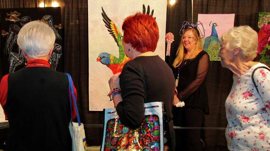 Australian quilter Helen Godden exhibits her Rainbow Lorikeet quilt at the opening of the 2012 International Quilt Festival at the George R. Brown Convention Center  Wednesday, Oct. 31, 2012, in Houston. Photo: Billy Smith II, Houston Chronicle / © 2012 Houston Chronicle