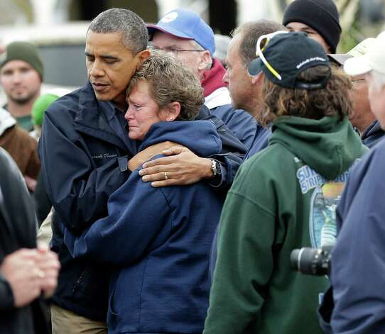 President Barack Obama, left, embraces Donna Vanzant, right, during a tour of a neighborhood effected by superstorm Sandy, Wednesday, Oct. 31, 2012 in Brigantine, N.J. Vanzant is a owner of North Point Marina, which was damaged by the storm. (AP Photo/Pablo Martinez Monsivais) Photo: Pablo Martinez Monsivais