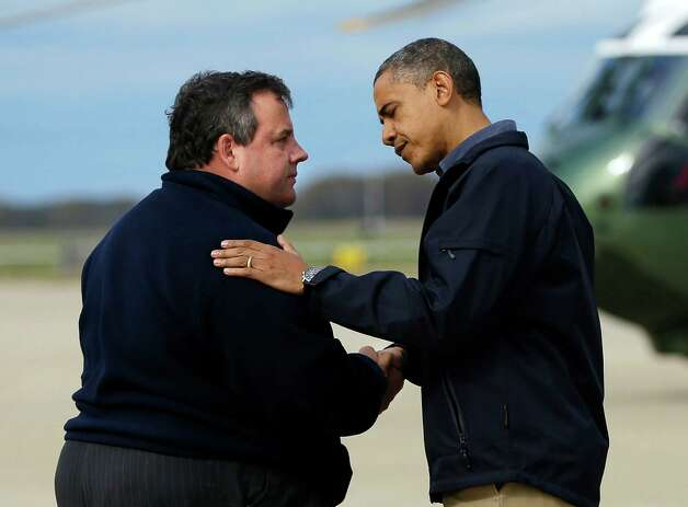 President Barack Obama is greeted by New Jersey Gov. Chris Christie upon his arrival at Atlantic City International Airport, Wednesday, Oct. 31, 2012, in Atlantic City, NJ. Obama traveled to the region to take an aerial tour of the Atlantic Coast in New Jersey in areas damaged by superstorm Sandy,  (AP Photo/Pablo Martinez Monsivais) Photo: Pablo Martinez Monsivais