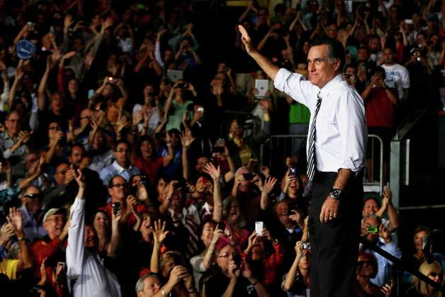 Republican presidential candidate, former Massachusetts Gov. Mitt Romney waves during a campaign stop at the Bank United Center, at The University of Miami, in Coral Gables, Florida, Wednesday, Oct. 31, 2012. (AP Photo/Charles Dharapak) Photo: Charles Dharapak