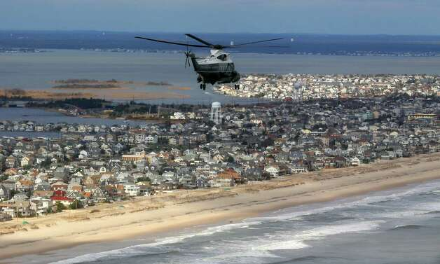 Marine One, carrying President Barack Obama and New Jersey Gov. Chris Christie,  take an aerial tour of the Atlantic Coast in New Jersey in areas damaged by superstorm Sandy, Wednesday, Oct. 31, 2012. (AP Photo/Doug Mills, Pool) Photo: Doug Mills