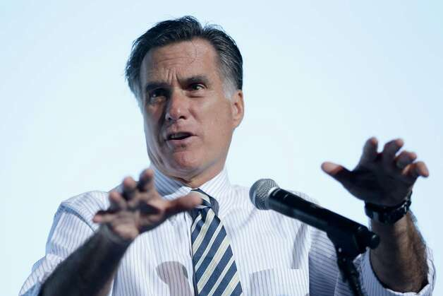 Republican presidential candidate, former Massachusetts Gov. Mitt Romney gestures while speaking at a campaign stop in Tampa, Fla., Wednesday, Oct. 31, 2012. (AP Photo/Charles Dharapak) Photo: Charles Dharapak