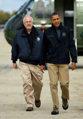President Barack Obama and Federal Emergency Management Agency (FEMA) administrator Craig Fugate walk across the tarmac from the Marine One helicopter, rear, before boarding Air Force One before their departure from Andrews Air Force Base, Md., Wednesday, Oct. 31, 2012. They were traveling to New Jersey to join New Jersey Gov. Chris Christie to see the relief efforts after superstorm Sandy. (AP Photo/Pablo Martinez Monsivais) Photo: Pablo Martinez Monsivais