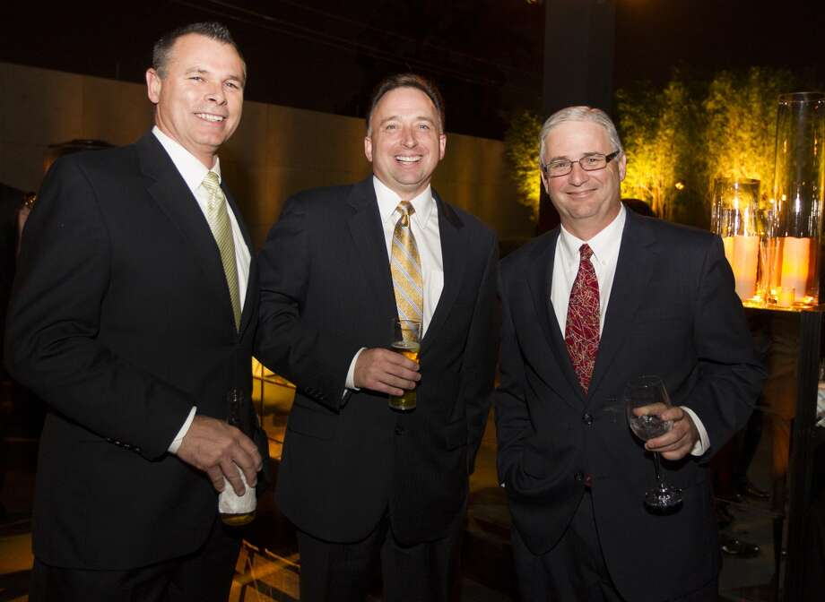 Ray McCutcheon, an  executive vice president at the San Antonio Express-News, left; Aldam and Chronicle Managing Editor Steve Proctor.