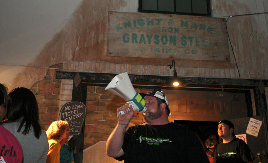Nightmare on Grayson manager Gordon Wise, calls out instructions for one of the last crowds, Wednesday, Oct. 31, 2012. The event is schedule to move out of the East Grayson Street location for the next run. Two more runs are scheduled for Friday and Saturday nights. Photo: Jerry Lara, San Antonio Express-News / San Antonio Express-News