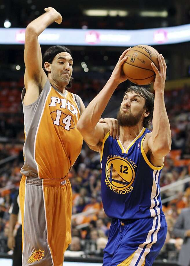 "Andrew Bogut, who had eight points and six rebounds and ""felt great"" in 18 minutes drives on Luis Scola. Photo: Paul Connors, Associated Press"