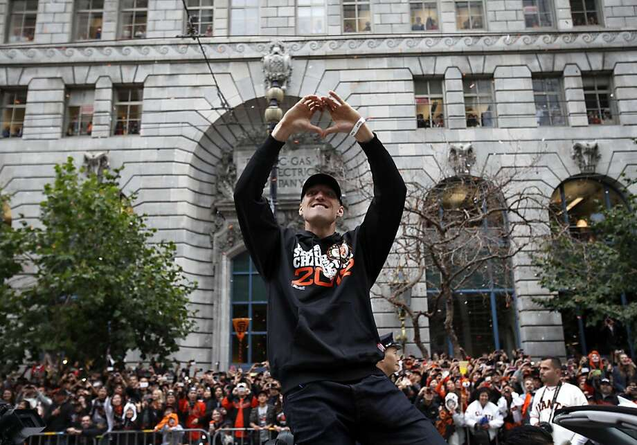 Right fielder Hunter Pence makes a heart sign to the crowd during the Giants' World Championship parade along Market Street to Civic Center. Photo: Sarah Rice, Special To The Chronicle