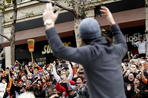 Tim Lincecum exhorts the crowd to get freaky while riding on Market Street.  Fans thronged the parade route for its entire journey. Photo: Sarah Rice, Special To The Chronicle