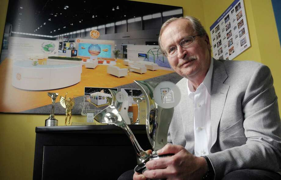 Gene Lindman, president at EP and M International, holds a few of the creative and design awards his company has won on Thursday, Oct. 25, 2012 in Albany, NY.  The company designs and manufactures elaborate trade show and permanent exhibits for companies all over the world.  (Paul Buckowski / Times Union) Photo: Paul Buckowski