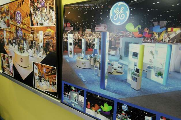 A view of some photographs of a trade show exhibit done for GE  by EP and M International are seen at EP and M's offices  on Thursday, Oct. 25, 2012 in Albany, NY.  The company designs and manufactures elaborate trade show and permanent exhibits for companies all over the world.  (Paul Buckowski / Times Union) Photo: Paul Buckowski