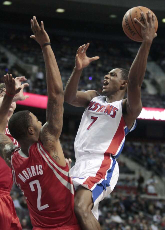 Pistons guard Brandon Knight (7) goes to the basket against Rockets forward Marcus Morris. (Duane Burleson / Associated Press)