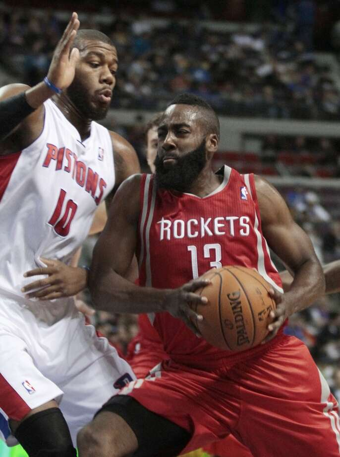 James Harden (13) drives to the basket against Pistons center Greg Monroe. (Duane Burleson / Associated Press)