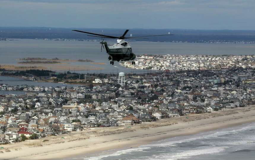 Marine One with US President Barack Obama on board flies over damage area in Seaside Heights, New Je