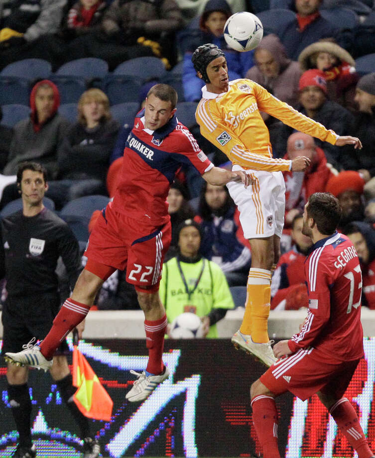 Houston Dynamo forward Calen Carr (3), right, heads the ball against Chicago Fire defender Austin Berry (22) during the second half of an MLS soccer playoffs on Wednesday, Oct. 31, in Bridgeview, Ill. The Dynamo won 2-1. (AP Photo/Nam Y. Huh) Photo: Nam Y. Huh, Associated Press / AP