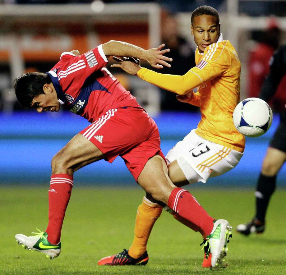 Houston Dynamo midfielder Ricardo Clark (13) battles for the ball with Chicago Fire midfielder Pavel Pardo (17) during the first half of their playoff MLS soccer match, Wednesday, Oct. 31, 2012, in Bridgeview, Ill. (AP Photo/Nam Y. Huh) Photo: Nam Y. Huh, Associated Press / AP